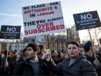 Protesters hold placards as they demonstrate in Parliament Square against anti-Semitism in the Labour Party on March 26, 2018 in London, England. The Board of Deputies of British Jews and the Jewish Leadership Council have drawn up a letter accusing Labour Leader Jeremy Corbyn of failing to address anti-Semitism in his party. Mr Corbyn has today apologised to Jewish groups for 'pockets of anti-Semitism' in Labour. (Photo by Jack Taylor/Getty Images)