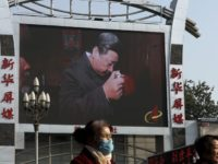 China Politics Hopes Dashed In this Nov. 16, 2017, photo, women walk by a TV screen showing a documentary footage of Chinese President Xi Jinping visiting a villager's house with a picture of late communist leader Mao Zedong, at the Beijing railway station in Beijing. Many Western scholars who studied China believed that the opening to the outside world engineered by reformer Deng Xiaoping in the early 1980s would pave the way for corresponding political freedoms. That vision has been categorically shattered under President Xi Jinping, who many once thought would be the next great reformer. In just five years, Xi has consolidated more power than any Chinese leader since Mao Zedong and is now primed to rule as president for life. (AP Photo/Andy Wong)