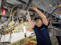 BRISTOL, ENGLAND - NOVEMBER 19: A skilled fitter works on the spoiler of a A400M at the Airbus aircraft manufacturer's Filton site on November 19, 2015 in Bristol, England. The site at Filton's main role is the designing and manufacture of wings, fuel and landing gear systems for all ranges of Airbus aircraft currently employing over 4,000 people. It is estimated another 100,000 jobs are generated in the UK by Airbus wing work, both directly as well as indirectly through an extended supply chain of over 400 companies. (Photo by Matt Cardy/Getty Images)