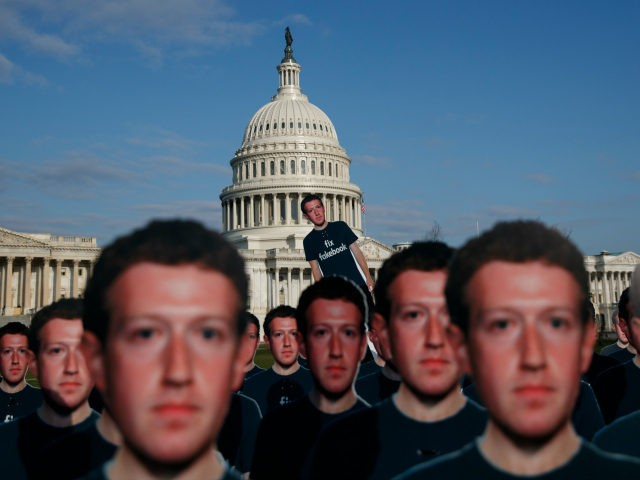 """Life-sized cutouts depicting Facebook CEO Mark Zuckerberg wearing """"Fix Fakebook"""" T-shirts are displayed by advocacy group, Avaaz, on the South East Lawn of the Capitol on Capitol Hill in Washington, Tuesday, April 10, 2018, ahead of Zuckerberg's appearance before a Senate Judiciary and Commerce Committees joint hearing. (AP Photo/Carolyn Kaster)"""
