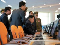 This undated picture released from North Korea's official Korean Central News Agency (KCNA) on October 29, 2015 shows North Korean leader Kim Jong-Un (2nd R) inspecting the Sci-Tech Complex at the Ssuk Islet in Pyongyang. AFP PHOTO / KCNA via KNS REPUBLIC OF KOREA OUT THIS PICTURE WAS MADE AVAILABLE BY A THIRD PARTY. AFP CAN NOT INDEPENDENTLY VERIFY THE AUTHENTICITY, LOCATION, DATE AND CONTENT OF THIS IMAGE. THIS PHOTO IS DISTRIBUTED EXACTLY AS RECEIVED BY AFP. ---EDITORS NOTE--- RESTRICTED TO EDITORIAL USE - MANDATORY CREDIT