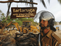 A Sri Lankan police officer looks on near a demolished illegally built Sri Lankan hotel that was bulldozed in the southern town of Unawatuna on December 13, 2011. Sri Lanka is experiencing a boom in tourism after security forces crushed the Tamil Tiger rebels in May 2009, ending 37-years of ethnic bloodshed. Tourist arrivals have risen to a record 758,458 from January to November this year, which is 33.1 percent more than the same figures reported in 2010. AFP PHOTO/ Ishara S. KODIKARA (Photo credit should read Ishara S. KODIKARA/AFP/Getty Images)