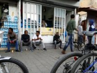 African migrants from Eritrea sit in the street in the southern district of Israel's Tel Aviv on April 5, 2018
