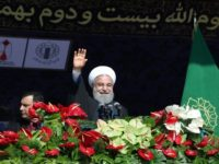 The government of Iranian President Hassan Rouhani, shown here addressing a rally in Tehran on February 11, 2018, has sought to encourage Iranians living abroad to return