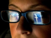 FILE: In this file photo the Facebook Inc. logo is reflected in the eyeglasses of a user in this arranged photo in San Francisco, California, U.S., on Wednesday, Dec. 7, 2011. A Facebook IPO would provide funds to help the social-networking service maintain its expansion and fend off competition from Internet rivals such as Google Inc. and Twitter Inc. Photographer: David Paul Morris/Bloomberg via Getty Images