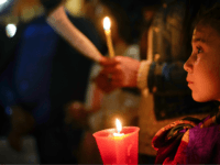 People hold candles as they attend a prayer vigil for terminally ill toddler Alfie Evans, in St. Peter's Square at the Vatican, Thursday, April 26, 2018. The British hospital treating Alfie Evans withdrew his life support Monday after a series of court rulings sided with the doctors and blocked further medical treatment. On Wednesday the Court of Appeal rejected a new bid by the parents to take Alfie to the Vatican's hospital in Rome. (AP Photo/Andrew Medichini)