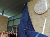 US Treasury Secretary Steve Mnuchin and US President's daughter Ivanka Trump unveil an inauguration plaque during the opening of the US embassy in Jerusalem on May 14, 2018. - The United States moved its embassy in Israel to Jerusalem after months of global outcry, Palestinian anger and exuberant praise from Israelis over President Donald Trump's decision tossing aside decades of precedent. (Photo by Menahem KAHANA / AFP) (Photo credit should read MENAHEM KAHANA/AFP/Getty Images)