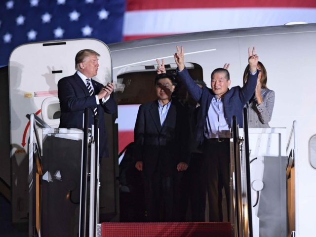 Trump welcomes Americans home (Saul Loeb / AFP / Getty)