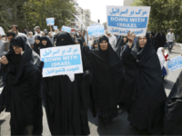 "Iranian women hold anti-Israeli placards at a protest after Friday prayer service in Tehran, Iran, Friday, Sept. 18, 2015. Hundreds of worshipers staged an anti-Israeli protest for its response to Palestinians protest against unusual numbers of Jewish visitors at Al-Aqsa mosque compound in recent days. Chanting ""Death to Israel"" and ""Death to the U.S.,"" demonstrators condemned an ""Israeli invasion to Al-Aqsa"" mosque. State TV said similar protests were held in several other major Iranian cities. (AP Photo/Vahid Salemi)"