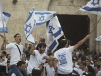 Israelis wave their national flags during a march outside Damascus Gate on May 13, 2018 in Jerusalem, Israel. Israel mark Jerusalem Day celebrations the 51th anniversary of its capture of Arab east Jerusalem in the Six Day War of 1967. One day before US will move the Embassy to Jerusalem. (Photo by Lior Mizrahi/Getty Images)