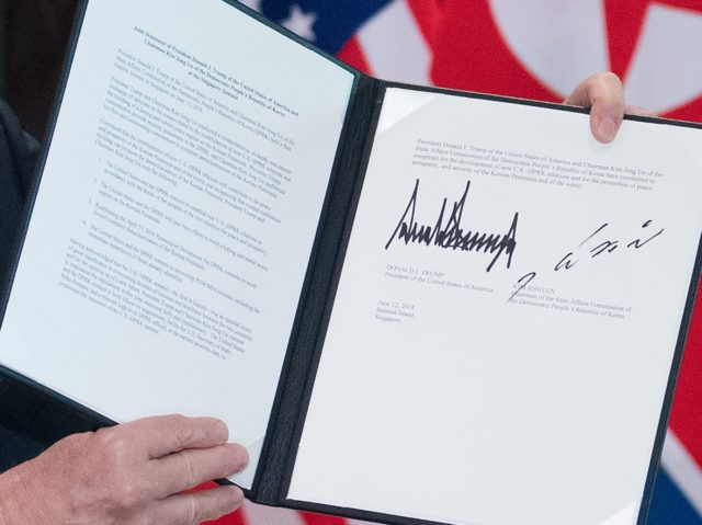 Trump Kim SIngapore document (Saul Loeb / AFP / Getty)