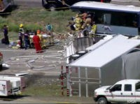 The Latest: Highway partially open after bus-truck crash