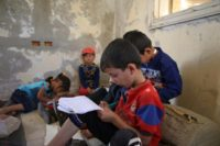 Displaced Syrian children attend class at a makeshift school in an opposition-held area in the west of the northern province of Aleppo