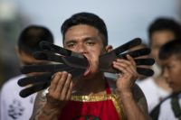 Religious devotees commit painful acts to purify themselves, taking on the sins of the community