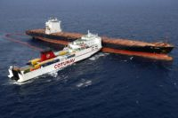 Aerial view taken from an helicopter on October 10 shows two cargo ships - the Tunisian freighter Ulysse (L) and the Cyprus-based vessel anchored CLS Virginia - after they collided about 30 kilometres (20 miles) off the northern tip of the French Mediterranean island of Corsica. Officials now say the …