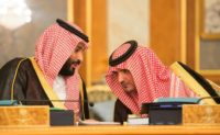 This handout picture provided by the Saudi Royal Palace on July 10, 2017, shows Saudi Crown Prince Mohammed bin Salman speaking with Interior Minister Prince Abdelaziz bin Saud bin Nayef during a cabinet meeting chaired by the king in Mecca