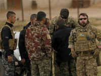 US forces and members of the Syrian Democratic Forces (SDF) patrol the Kurdish-held town of Al-Darbasiyah in northeastern Syria bordering Turkey