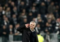 Manchester United's Jose Mourinho gestures towards the Juventus fans