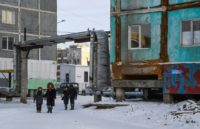 Many houses in Yakutsk are made up of concrete panels and stand on stilts which ensure ventilation of the building's underbelly and prevent it from heating the permafrost, the layer of mineral cemented together with water which is stable as long as it stays frozen. But warmer temperatures are threatening …