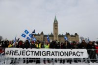 Right-wing protesters rally against the UN international pact on migration at Parliament Hill in Ottawa