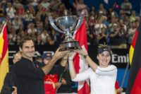Roger Federer and his mixed doubles partner Belinda Bencic of Switzerland with the Hopman Cup after defeating runners-up Alexander Zverev and Angelique Kerber of Germany