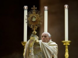 Pope Francis holds the monstrance during a mass in Saint Peter square at the Vatican on September 7, 2013. Pope Francis has called for a global day of fasting and prayer on Saturday for peace in Syria and against any armed intervention. AFP PHOTO / Filippo MONTEFORTE (Photo credit should …