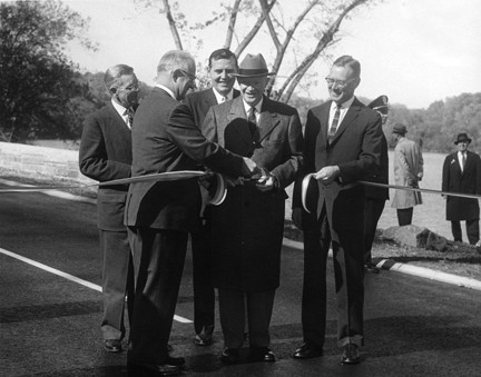 President Dwight D. Eisenhower participates in the ribbon-cutting ceremony opening the new extension to the George Washington Memorial Parkway on November 3, 1959.