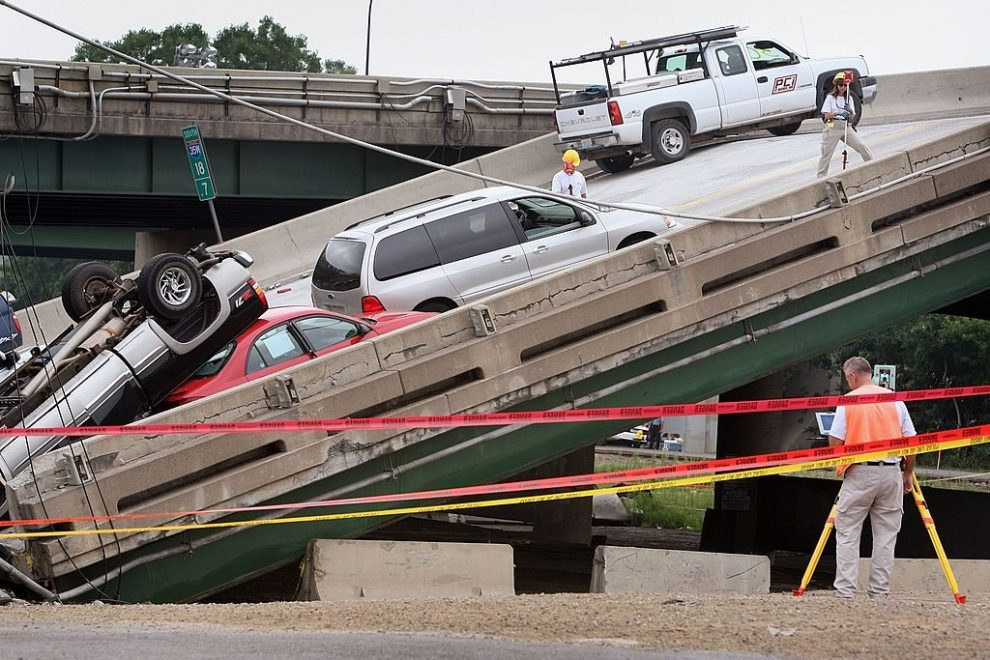 MINNEAPOLIS - AUGUST 06: FBI agents investigates the scene of the I-35W bridge collapse August 6, 2007 in Minneapolis, Minnesota. The job of removing debris and destroyed cars, the cost of which is estimated to be up to $15 million, was to begin today after Minnesota Department of Transportation officials said they had hired a St. Paul contractor. Searchers reported finding no new victims to add to the list of five confirmed dead. (Photo by Scott Olson/Getty Images)