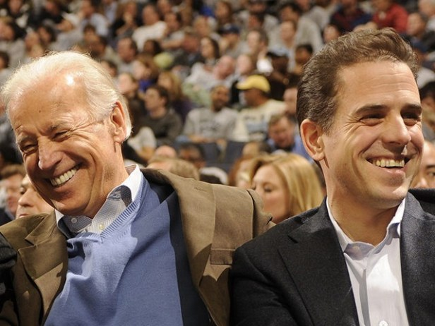 WASHINGTON - JANUARY 30: President of the United States Barack Obama and Vice President Joe Biden and Hunter Biden (son of Joe Biden) talk during a college basketball game between Georgetown Hoyas and the Duke Blue Devils on January 30, 2010 at the Verizon Center in Washington DC. (Photo by …