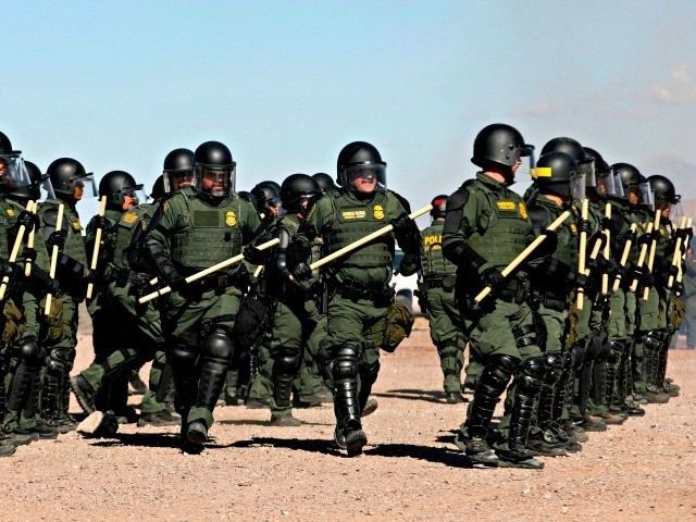 U.S. Border Patrol agents conduct a training exercise in the Anapra area, in front of the wall that divides Sunland Park, New Mexico, US, from Mexico, as seen from Ciudad Juarez, Chihuahua state, on January 31, 2020. (Photo by Herika Martinez / AFP) (Photo by HERIKA MARTINEZ/AFP via Getty Images)