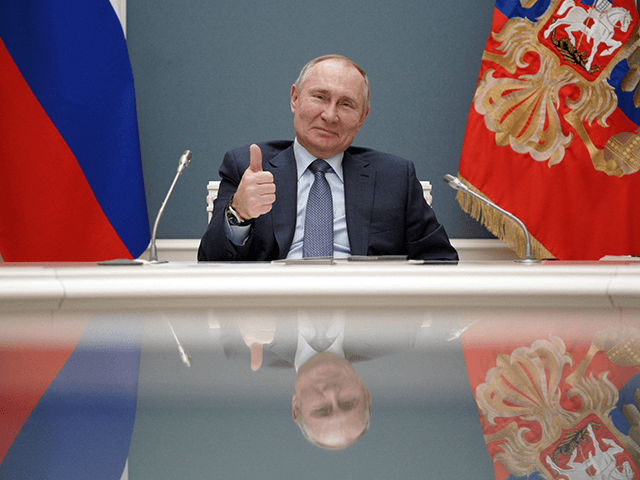 Russian President Vladimir Putin participates via video link in a ceremony to launch the construction of a third reactor of the Turkish nuclear power plant built by Russia's energy giant Rosatom, in Moscow on March 10, 2021. (Photo by Alexey DRUZHININ / SPUTNIK / AFP) (Photo by ALEXEY DRUZHININ/SPUTNIK/AFP via …