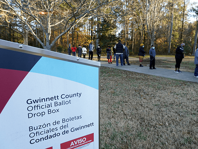 Voters stand in line to cast their ballots during the first day of early voting in the US Senate runoffs at Lenora Park, December 14, 2020, in Atlanta, Georgia. - Six weeks after the contentious US presidential election, early in-person voting began Monday in Georgia ahead of a new fateful political moment: twin runoff races that will determine the balance of power in the Senate. The southeastern state's highly-anticipated January 5 runoffs have garnered national attention as the outcome will help determine how much of President-elect Joe Biden's ambitious political agenda can get through Congress and into law. (Photo by Tami Chappell / AFP) (Photo by TAMI CHAPPELL/AFP via Getty Images)