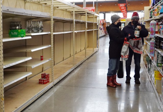 An empty water bottle shelf is bare as people stock up on necessities at the H-E-B grocery store on February 18, 2021 in Austin, Texas. Winter storm Uri has brought historic cold weather and power outages to Texas as storms have swept across 26 states with a mix of freezing temperatures and precipitation. (Photo by Joe Raedle/Getty Images)