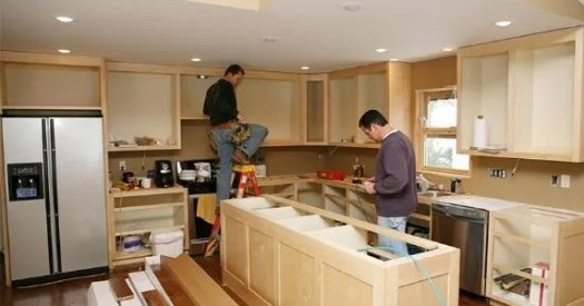 Men Working On Cabinets For Kitchen Remodel George Peters Getty Images