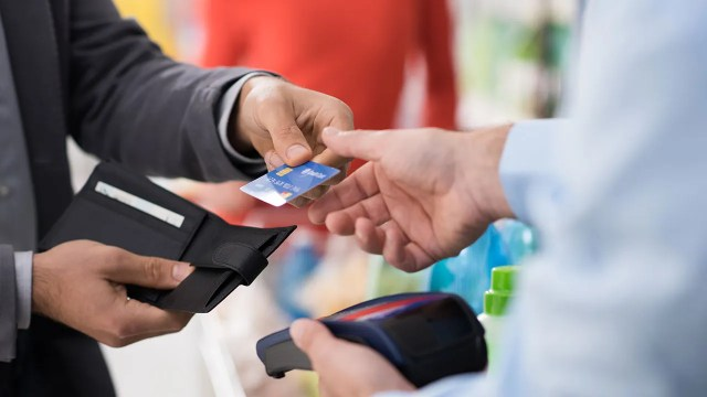 Man paying with with credit card