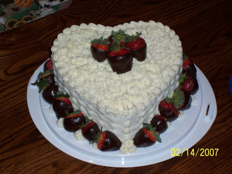 It is strawberry cake with the crusting cream cheese icing. Chocolate dipped