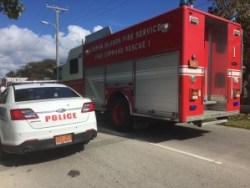 Cayman Islands Fire Service truck and RCIPS car