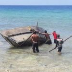 Cubans come ashore after six days at sea
