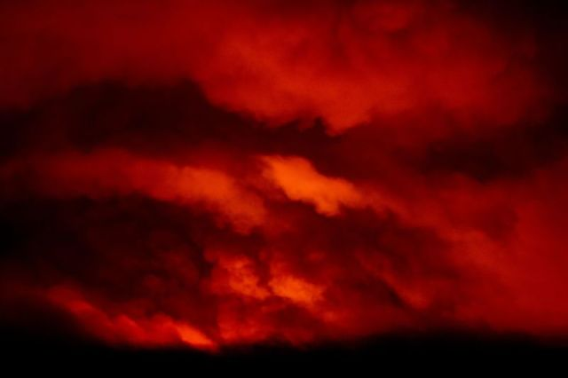 Fire from the Bootleg Fire illuminates smoke near Bly, Oregon, on the night of July 16.