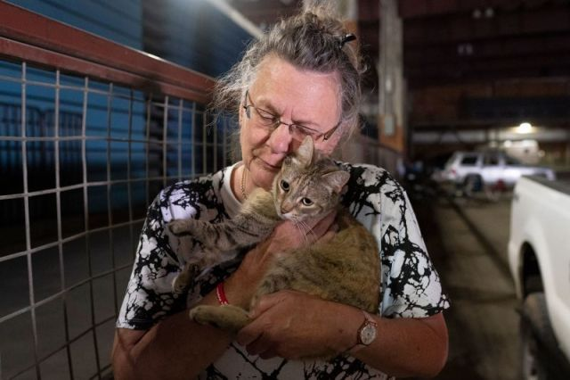 Evacuee Dee McCarley hugs her cat Bunny at a Red Cross center in Klamath Falls, Oregon, on July 14.