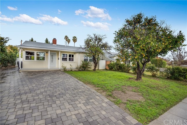 All offers due Sunday, 1/27, at 5:00 P.M. Gorgeous traditional home located in Granada Hills Charter High School District. Built in 1951, it includes 3 bedrooms (den used as 3rd bedroom), 1 bathroom, 1,036 square feet of living space and a 9,488 square foot lot. Enter the comfortable living room which is highlighted by the cozy brick fireplace. Adjacent is the light filled dining area with a sliding door that opens to the patio and backyard. The beautifully remodeled kitchen includes Mocha colored wood cabinets, stone counter top, stainless steel appliances, tile flooring and recessed lighting. The bedrooms include roomy closets and are serviced by the tastefully remodeled bathroom. The massive backyard includes a paver patio area, large grass area,  and two double detached garages. Additional features include fresh interior paint, newer exterior paint, newer laminate flooring, newer central air & heat, newer windows, newer tankless water heater, newer paver driveway, newer roof and newer electrical panel.