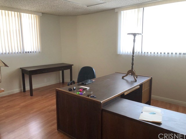 What a an opportunity for service industries. 3 suites with 2 separate entrances. Occupies 12 A and B. Condominium type. Built in 1981 and has 985 sq. ft. New wood like flooring and paint, ready for occupancy.