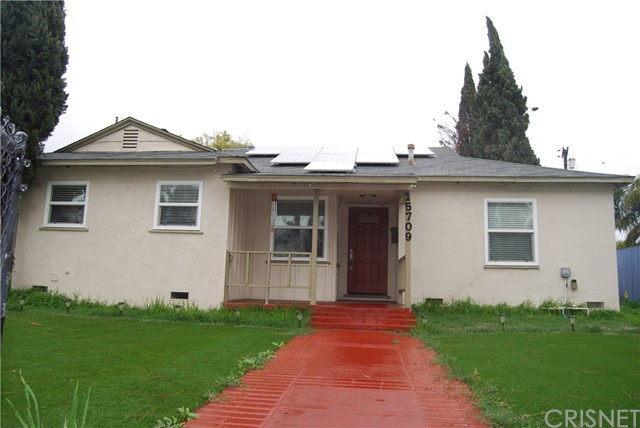 This beautifully remodeled single story home is a commuter's dream! It is located within walking distance to the local shopping center and a few homes away from the 405 FWY exit. The home welcomes you in with hardwood flooring throughout. The kitchen has been upgraded and features dark stain cabinets and dark granite countertops, it is perfect for the cook in the family! The indoor laundry area off the kitchen is conveniently located away from the main living areas in the home. There is an added bedroom off the dining/living room with a full private bathroom that is perfect for guest or in-laws for a total of 4bedrooms and 3 bathrooms in this home (buyer to verify permits). Solar panels help energy efficiency and the backyard features a covered patio, two car garage with alley access, and plenty of room for a garden or a play area. Don't forget CSUN is just a few minutes away!*This home qualifies for NHS down payment assistance program for low monthly payments!
