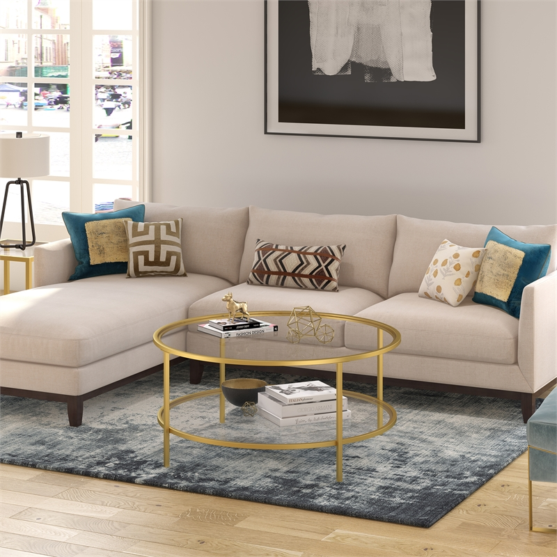 henn hart two shelf round metal base coffee table in brass with glass top