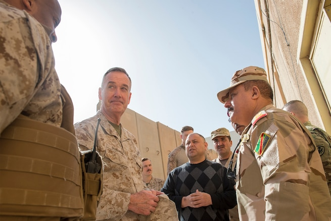 U.S. Marine Corps Gen. Joseph F. Dunford Jr., center left, chairman of the Joint Chiefs of Staff, listens to Marine Col. David Coconut, left, during a group discussion with Iraqi commanders on Al Asad Air Base, Iraq, Jan. 8, 2016. Dunford met with U.S. and coalition leaders to assess progress in the Counter-ISIL efforts. DoD photo by Navy Petty Officer 2nd Class Dominique A. Pineiro