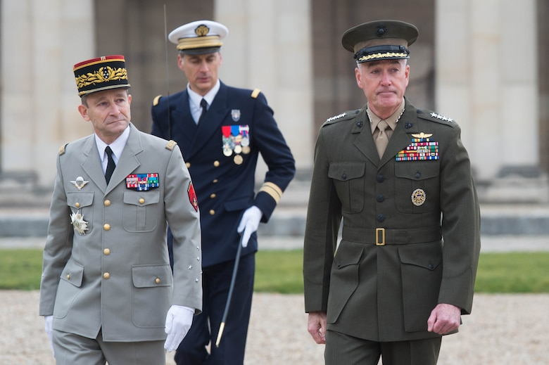 Marine Corps Gen. Joseph F. Dunford Jr., right, chairman of the Joint Chiefs of Staff, and Gen. Pierre de Villiers, chief of France's defense staff, conduct a military honors ceremony at Ecole Militarie, a military school, in Paris, Jan. 22, 2016. DoD photo by D. Myles Cullen