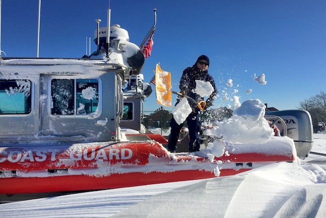 Coast Guard Petty Officer 2nd Class Richard Clarke III shovels snow off the deck of a 25-foot Coast Guard boat on Coast Guard Station Sandy Hook, N.J., Jan. 24, 2016. A massive snowstorm hit the mid-Atlantic and East Coast Jan. 22-23, leaving more than two feet in most areas. U.S. Coast Guard photo by Petty Officer 1st Class Ty Coulter