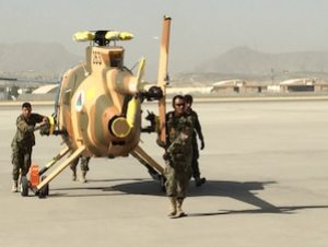 Members of the Afghan air force wheel out a new MD-530 Cayuse Warrior helicopter at the 438th Air Expeditionary Wing/Train, Advise, Assist Command-Air in Kabul, Afghanistan, July 16, 2016. DoD photo by Lisa Ferdinando