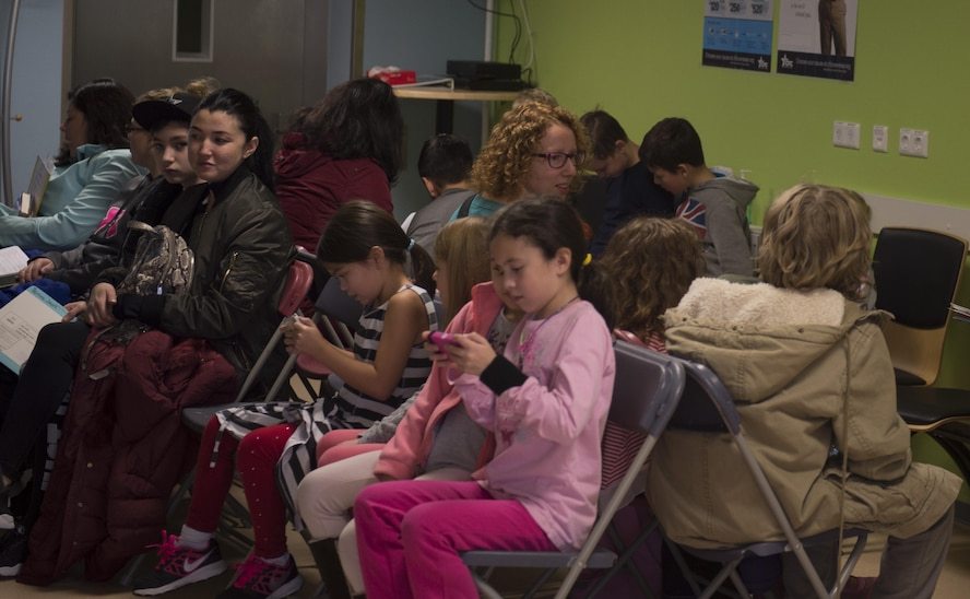 Family members of the 52nd Fighter Wing wait in the 52nd Dental Squadron's lobby during the semi-annual walk-in kiddie clinic at Spangdahlem Air Base, Germany, Nov. 4, 2016. The clinic offers routine cleanings and checkups for children up to the age of 13. (U.S. Air Force photo by Senior Airman Dawn M. Weber)