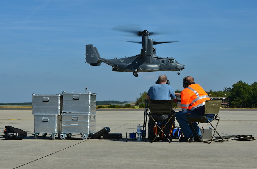 Local sound engineers watch and listen as a U.S. Air Force CV-22 Osprey Aircraft, assigned to the 352nd Special Operations Wing, Royal Air Force Mildenhall, England hovers over the flightline at Spangdahlem Air Base, Germany, Sept. 21, 2016. The engineers performed acoustic testing on the CV-22 at Spangdahlem from Sept. 20-23.  (U.S. Air Force photo by 1st Lt. Meredith Mulvihill)